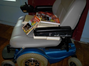 Books and the chair that gets 'em (and me) anywhere.